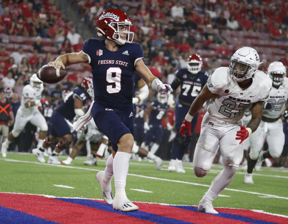 Fresno State quarterbak Jake Haener faced pressure from UNLV and was down two scores in the second half but led another terrific comeback. (AP Photo/Gary Kazanjian)