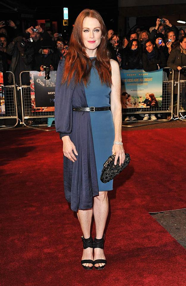 """<b>October</b>: Julianne Moore had an identity crisis while picking out her attire for the London premiere of """"The Kids Are All Right."""" While blue is definitely her color, the redheaded actress bombed in this bizarre two-toned Lanvin frock, which she accessorized with a mismatched bejeweled clutch and black sandals. Jon Furniss/<a href=""""http://www.wireimage.com"""" target=""""new"""">WireImage.com</a> - October 25, 2010"""
