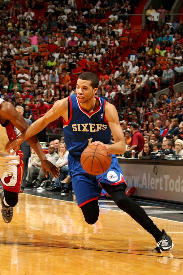 MIAMI, FL - April 16: Michael Carter-Williams #1 of the Philadelphia 76ers drives against the Miami Heat at the American Airlines Arena in Miami, Florida on April 16, 2014. (Photo by Issac Baldizon/NBAE via Getty Images)