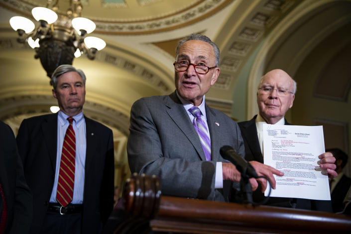 Senate Minority Leader Sen. Chuck Schumer, center, holds a letter to Kenneth Hersh of the George W. Bush Presidential Library and Museum requesting documents on Kavanaugh on July 24, 2018, in Washington, D.C. (Photo: Al Drago/Getty Images)