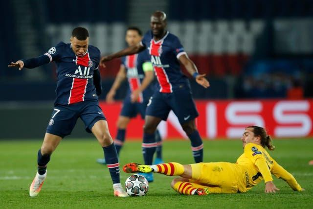 Kylian Mbappe, left, scored four goals in this Champions League tie (Christophe Ena/AP/PA)