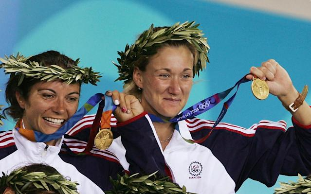 Kerri Walsh (R) and Misty May of United States celebrate as they receive their gold medals during the women's Beach Volleyball medal ceremony on August 24, 2004 during the Athens 2004 Summer Olympic Games at the Olympic Beach Volleyball Centre at the Faliro Coastal Zone Complex in Athens, Greece.