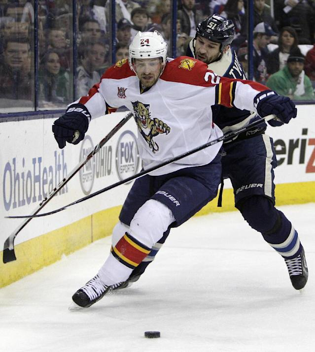 Florida Panthers' Brad Boyes, left, and Columbus Blue Jackets' Fedor Tyutin, of Russia, chase a loose puck during the first period of an NHL hockey game Son aturday, Feb. 1, 2014, in Columbus, Ohio. (AP Photo/Jay LaPrete)