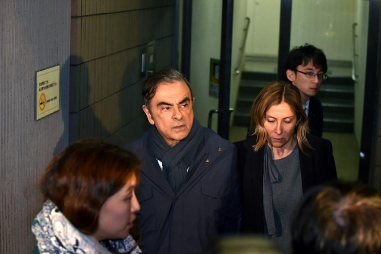 Carole Ghosn stayed close by her husband when he was released on bail