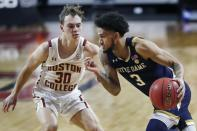 Notre Dame's Prentiss Hubb (3) drives past Boston College's Sam Holtze (30) during the first half of an NCAA college basketball game, Saturday, Feb. 27, 2021, in Boston. (AP Photo/Michael Dwyer)