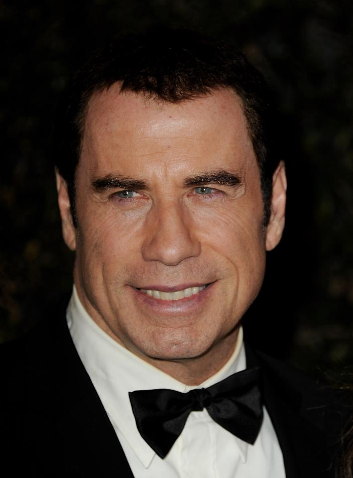 LOS ANGELES, CA - NOVEMBER 12:  Actor John Travolta arrives at the Academy of Motion Picture Arts and Sciences' 3rd Annual Governors Awards at the Hollywood & Highland Grand Ballroom on November 12, 2011 in Los Angeles, California.  (Photo by Kevin Winter/Getty Images)