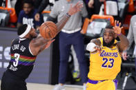 Los Angeles Lakers' LeBron James (23) passes the ball past Denver Nuggets' Torrey Craig (3) during the second half of an NBA conference final playoff basketball game Thursday, Sept. 24, 2020, in Lake Buena Vista, Fla. (AP Photo/Mark J. Terrill)