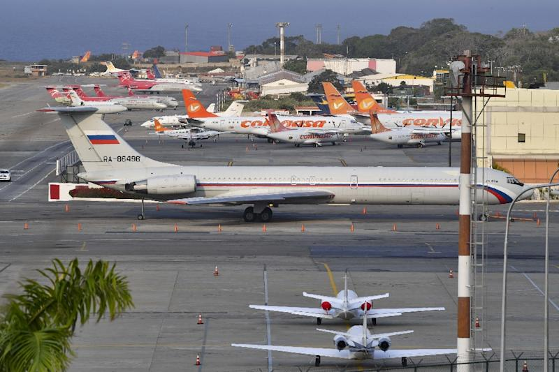 A Russian Ilyushin Il-62 air force plane, one of two Russian military aircraft that arrived on March 23, 2019 with troops and equipment, sits on the tarmac at an airport near Caracas; the Trump administration has sharply protested the Russian presence