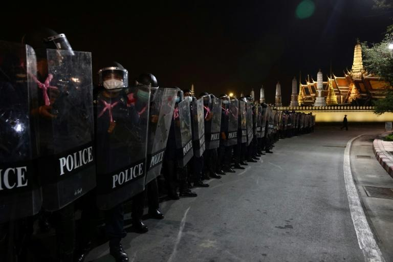 Scores of police in full riot gear faced off with the protesters, some of whom were wielding white shields, gas masks and helmets
