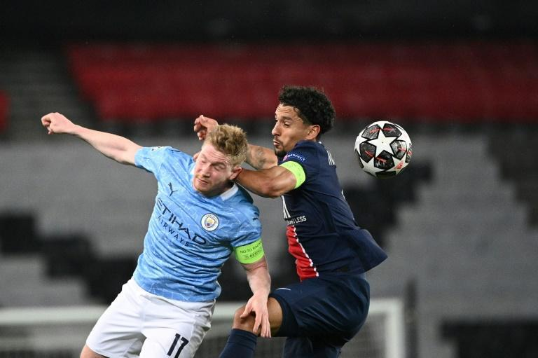 Champions League favourites Paris Saint-Germain and Manchester City have been paired together in Group A alongside RB Leipzig and Club Brugge (AFP/Anne-Christine POUJOULAT)