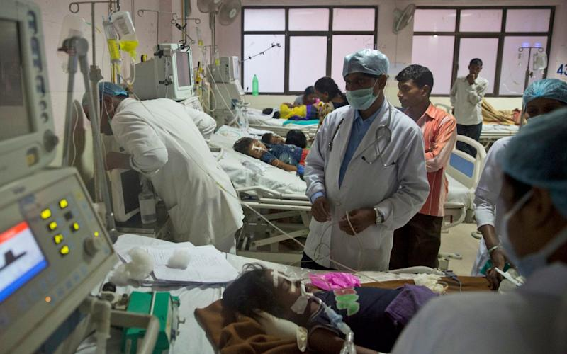 India needs to hire a further 600,000 doctors, the report warns - AP
