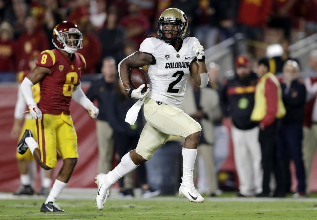 FILE - In this Oct. 13, 2018, file photo, Colorado wide receiver Laviska Shenault Jr. runs for a touchdown after a reception past Southern California cornerback Iman Marshall (8) in the first half of an NCAA college football game in Los Angeles. The Buffaloes are hoping for a big boost with the possible return of star sophomore Laviksa Shenault Jr. when they host 10th-ranked Washington State on Saturday. (AP Photo/Marcio Jose Sanchez, File)