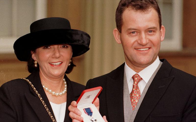 Paul Burrell, right, with his wife Maria in 1997 - Credit: JOHN STILLWELL/PA