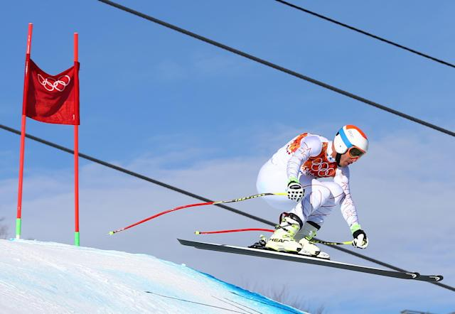 United States' Bode Miller jumps during a men's downhill training run for the Sochi 2014 Winter Olympics, Saturday, Feb. 8, 2014, in Krasnaya Polyana, Russia. (AP Photo/Alessandro Trovati)