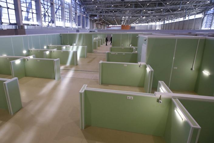 Workers erect a temporary coronavirus hospital in Moscow on May 7, 2020.
