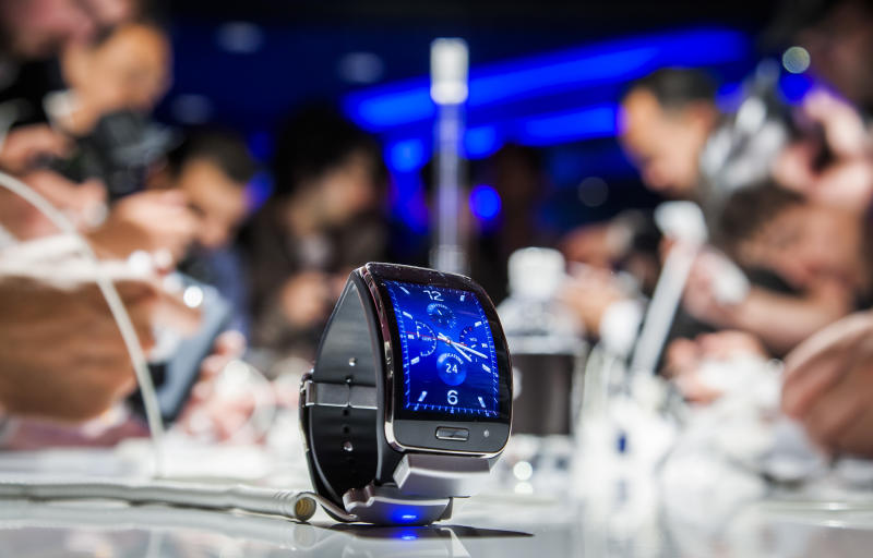 """A Samsung Gear S, a new mobile watch device, is seen during an event in Berlin on September 3, 2014, in advance of the consumer electronics trade fair """"Internationale Funk Ausstellung """"(IFA) (AFP Photo/Odd Andersen)"""