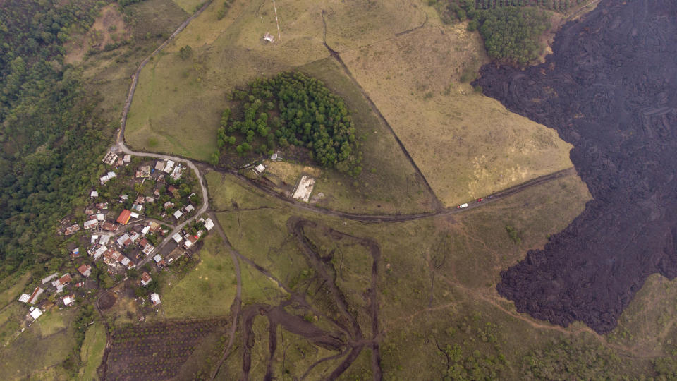 Lava flows down the slopes of the Pacaya Volcano near El Patrocinio village in San Vicente Pacaya, Guatemala, Wednesday, April 21, 2021. The 8,373-foot volcano, just 30 miles south of Guatemala's capital, has been active since early February. (AP Photo/Moises Castillo)