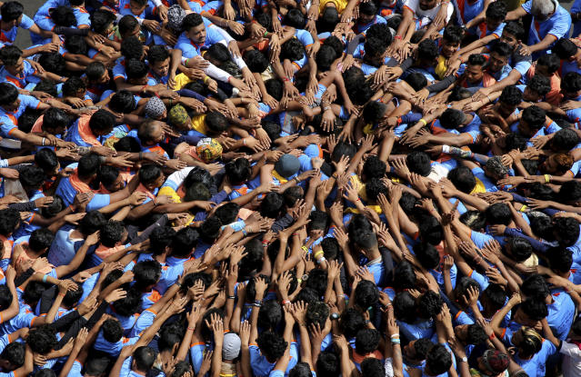 """<p>Indian youths form a human pyramid to break the """"Dahi handi,"""" an earthen pot filled with curd hanging above them, as part of celebrations to mark the Janmashtami festival in Mumbai, India, Monday, September 3. 2018. (AP Photo/Rafiq Maqbool) </p>"""