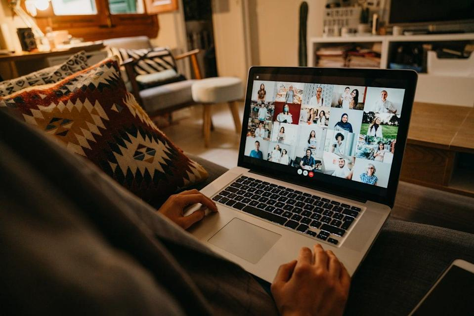 <p>A young woman uses a laptop on the sofa at home to have a work conference call.</p> (Getty Images/iStockphoto)