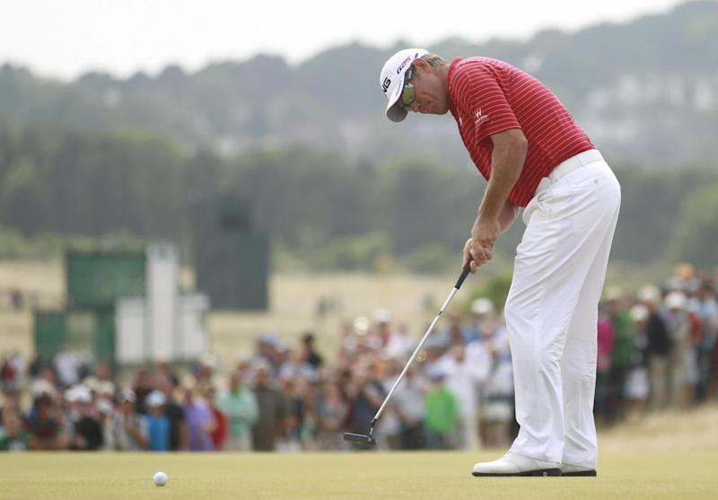Lee Westwood of England putts on the 4th green during the final round of the British Open Golf Championship at Muirfield, Scotland, Sunday July 21, 2013. (AP Photo/Peter Morrison)