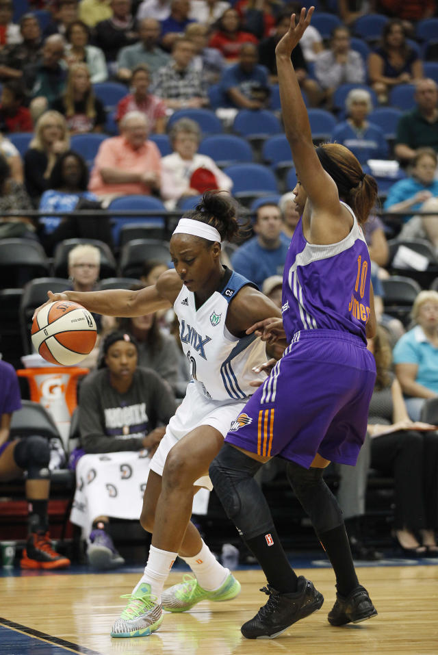Minnesota Lynx guard Monica Wright (22) dribbles against Phoenix Mercury guard Jasmine James (10) during the first half of a WNBA basketball game, Wednesday, July 24, 2013, in Minneapolis. (AP Photo/Stacy Bengs)
