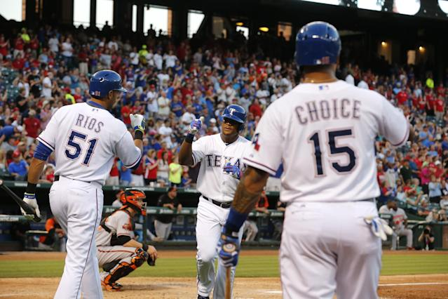 Texas Rangers' Alex Rios (51). Adrian Beltre and Michael Choice (15) celebrate Beltre's home run during the fourth inning of a baseball game against the Baltimore Orioles on Tuesday, June 3, 2014, in Arlington, Texas. (AP Photo/Sharon Ellman)