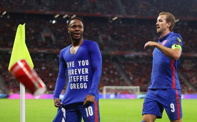 <strong>Raheem Sterling celebrates with Harry Kane after scoring their team's first goal wearing a T-shirt that reads