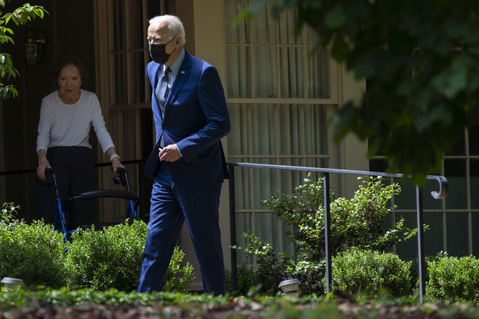 Former first lady Rosalynn Carter looks on as President Joe Biden leaves the home of former President Jimmy Carter during a trip to mark Biden's 100th day in office, Thursday, April 29, 2021, in Plains, Ga. (AP Photo/Evan Vucci)