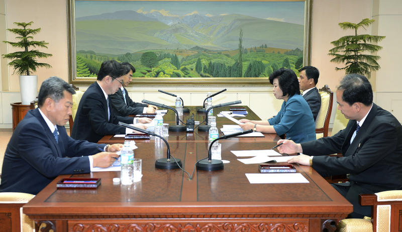 In this photo released by the South Korean Unification Ministry, South Korea's Unification Policy Officer Chun Hae-sung, left, and the head of North Korea's delegation Kim Song Hye read statements during their meeting at the southern side of Panmunjom, which has separated the two Koreas since the Korean War, in Paju, South Korea, Monday, June 10, 2013. The rival Koreas will hold senior-level talks this week in Seoul, South Korea said Monday, a breakthrough of sorts after Pyongyang's recent threats of nuclear war and Seoul's vows of counterstrikes. (AP Photo/South Korean Unification Ministry)