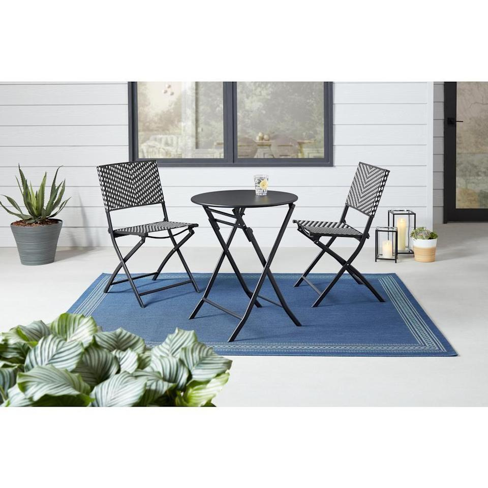 """<p><strong>StyleWell</strong></p><p>homedepot.com</p><p><strong>$139.00</strong></p><p><a href=""""https://go.redirectingat.com?id=74968X1596630&url=https%3A%2F%2Fwww.homedepot.com%2Fp%2FStyleWell-Mix-and-Match-Black-and-White-3-Piece-Steel-Wicker-Outdoor-Bistro-Folding-Set-FDS40081-ST%2F314035859&sref=https%3A%2F%2Fwww.goodhousekeeping.com%2Fhome%2Fgardening%2Fadvice%2Fg495%2Fsmall-garden-ideas%2F"""" rel=""""nofollow noopener"""" target=""""_blank"""" data-ylk=""""slk:Shop Now"""" class=""""link rapid-noclick-resp"""">Shop Now</a></p>"""