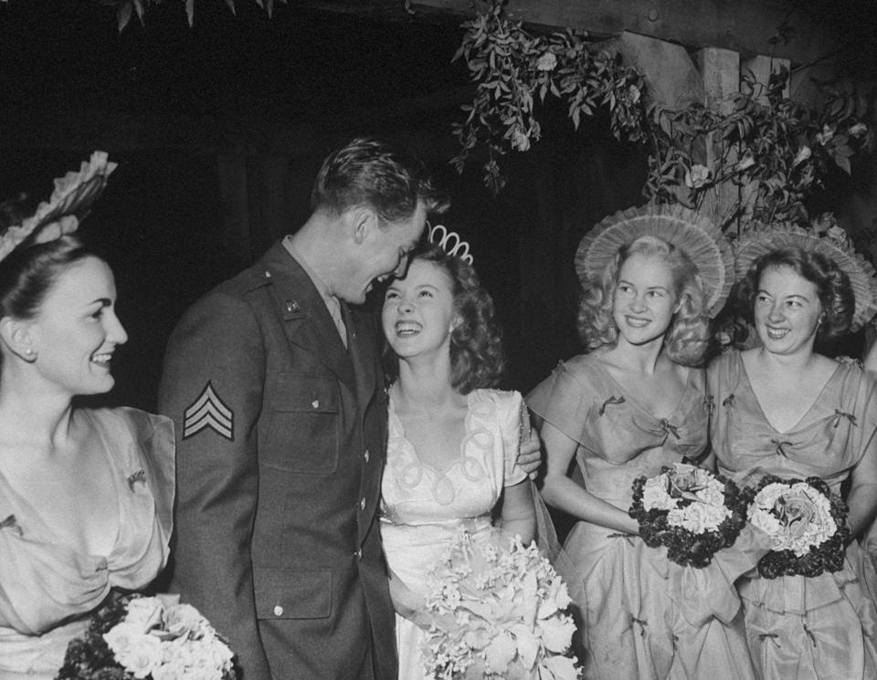 <p>Child star Shirley Temple married John Agar at the Wilshire Methodist Church in Los Angeles, California in 1945. The bride wore a silk gown with pearl detailing and hosted the reception at her Hollywood home. </p>