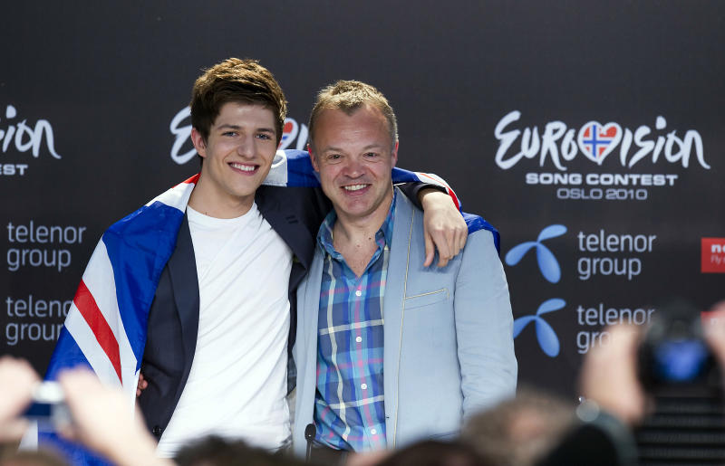 Josh Dubovie of United Kingdom and Graham Norton attend the press conference held after a final dress rehearsal of the Eurovision Song Contest on May 28, 2010 in Oslo, Norway. (Photo by Nigel Waldron/Getty Images)