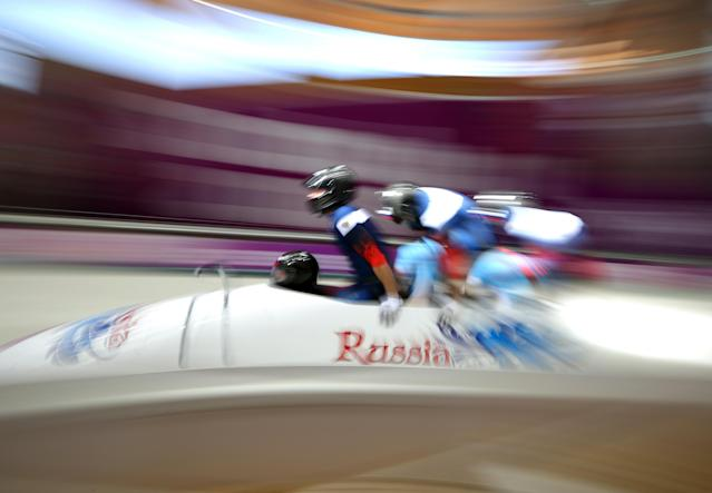 SOCHI, RUSSIA - FEBRUARY 23: Alexander Zubkov, Alexey Negodaylo, Dmitry Trunenkov and Alexey Voevoda of Russia team 1 make a final run during the Men's Four Man Bobsleigh on day 16 of the Sochi 2014 Winter Olympics at Sliding Center Sanki on February 23, 2014 in Sochi, Russia. (Photo by Robert Cianflone/Getty Images)