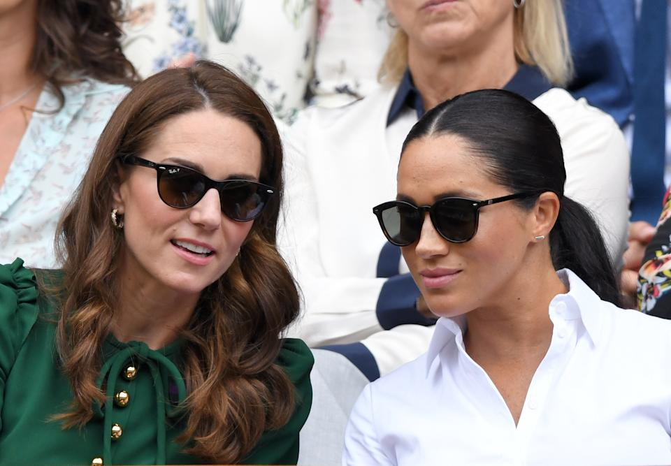 Meghan, Duchess of Sussex wearing Le Specs Bandwagon sunglasses at Wimbledon in 2019 with her sister-in-law, Catherine, Duchess of Cambridge. (Photo by Karwai Tang/Getty Images)