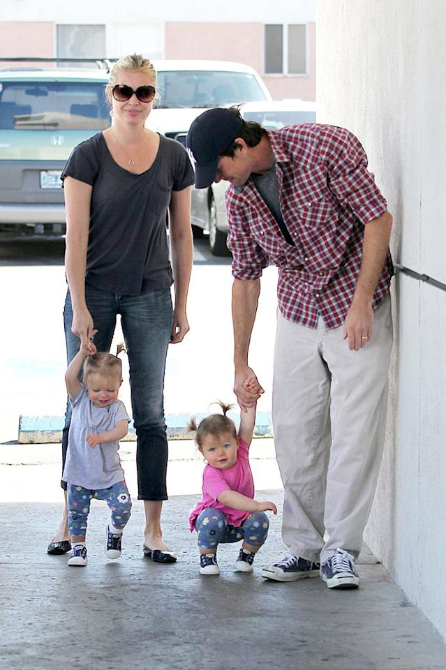 """The 1-year-old cuties tested out their walking skills ... with a little help from their mom and dad. Sam Sharma/<a href=""""http://www.pacificcoastnews.com/"""" target=""""new"""">PacificCoastNews.com</a> - March 14, 2010"""