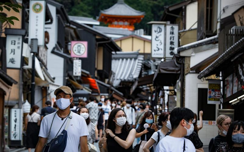 Thousands of tourists flocked to Japan's ancient capital of Kyoto as the country's controversial GoTo tourism subsidy campaign kicked off despite concerns over rising number infections - DAI KUROKAWA/EPA-EFE/Shutterstock