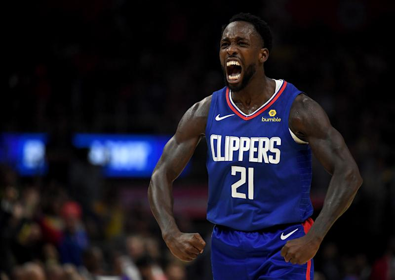 Patrick Beverley #21 of the LA Clippers reacts to a Montrezl Harrell #5 basket and foul in a 112-102 win over the Los Angeles Lakers during the LA Clippers season home opener at Staples Center on October 22, 2019 in Los Angeles, California. (Photo by Harry How/Getty Images)