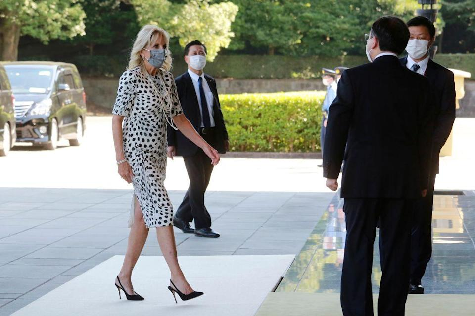 U.S. first lady Jill Biden arrives at Imperial Palace to meet Japan's Emperor Naruhito in Tokyo, Friday, July 23, 2021. - Credit: AP