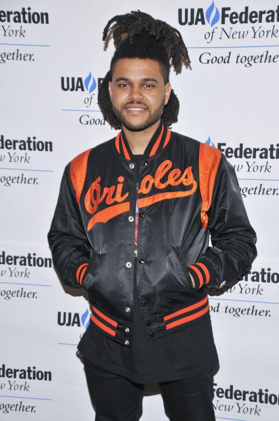 <p>The Weeknd changed his hairstyle in 2014 with a half-up style, featuring longer locs hanging down in the back with the top section in a ponytail. </p>