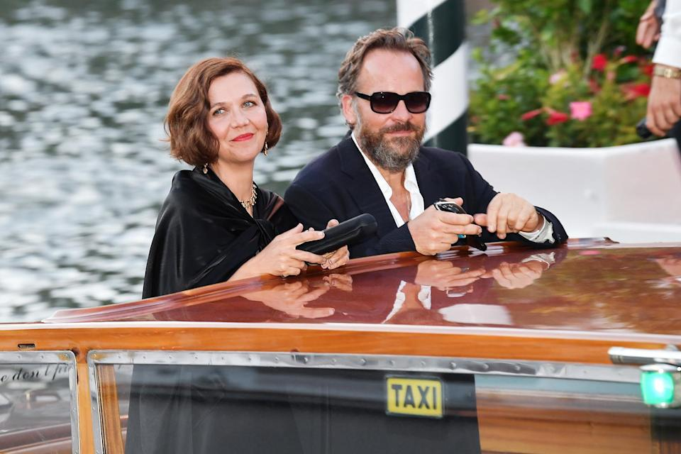 <p>Maggie Gyllenhaal — who made her directorial debut at this year's festival with <em>The Lost Daughter</em> — arrived on Sept. 2 with husband Peter Sarsgaard (who also acted in the film). </p>