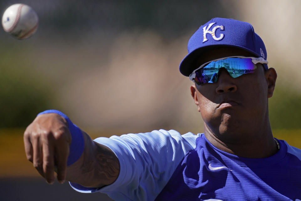 Kansas City Royals catcher Salvador Perez throws during spring training baseball practice Wednesday, Feb. 24, 2021, in Surprise, Ariz. (AP Photo/Charlie Riedel)