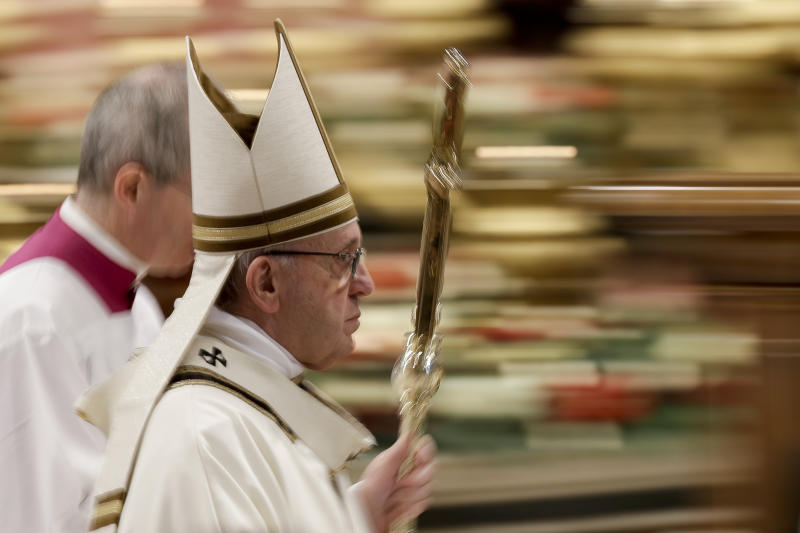 "In this photo taken with slow shutter speed Pope Francis leaves after celebrating an Epiphany Mass in St. Peter's Basilica at the Vatican, Sunday, Jan. 6, 2019. Pope Francis has appealed to European leaders to show ""concrete solidarity"" to 49 migrants stranded aboard a pair of rescue vessels. Francis, addressing faithful in St. Peter's Square Sunday, noted that the migrants, rescued in the Mediterranean. (AP Photo/Andrew Medichini)"