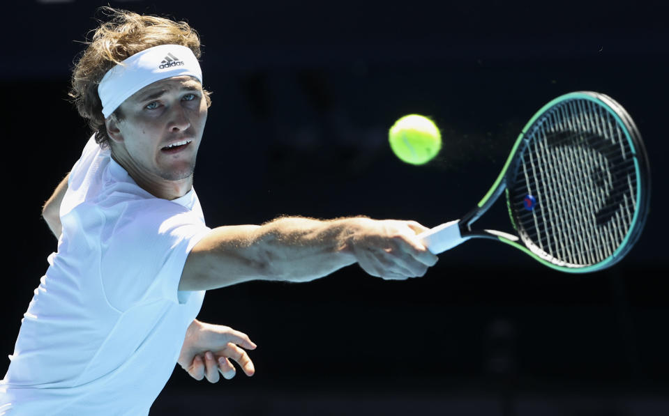 Germany's Alexander Zverev makes a backhand return to Canada's Denis Shapovalov during their ATP Cup match in Melbourne, Australia, Wednesday, Feb. 3, 2021. (AP Photo/Hamish Blair)