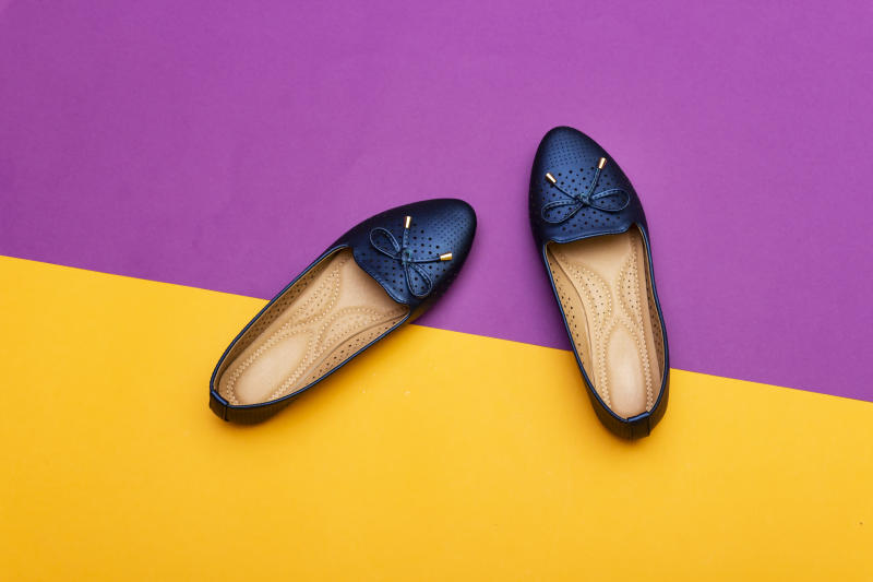 Stylish female blue flat shoes. Beauty and fashion concept. Flat lay, top view