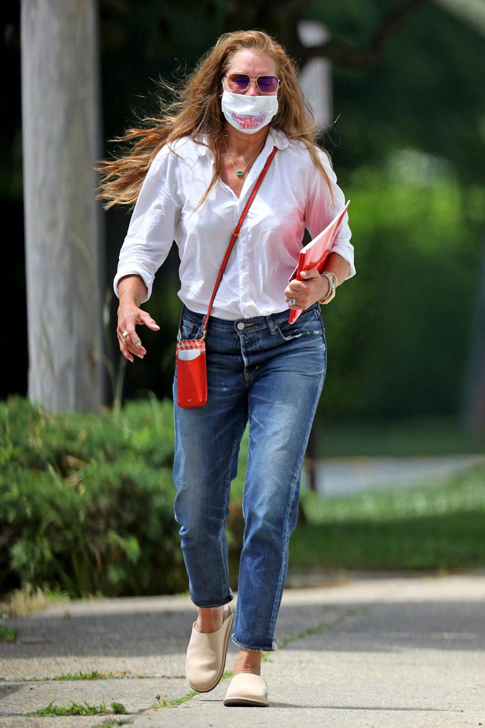 <p>Brooke Shields adds a pop of color to her ensemble on Wednesday during an outing in Southampton, New York.</p>