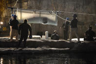 A Beluga whale is transported at Mystic Aquarium after arriving from Canada, Friday, May 14, 2021 in Mystic, Conn. A total of five Beluga whales from Marineland in Niagara Falls, Ontario,Canada will be moved to the aquarium. The whales will be leaving an overcrowded habitat with about 50 other whales and will be at the center of important research designed to benefit Belugas in the wild. (AP Photo/Jessica Hill)