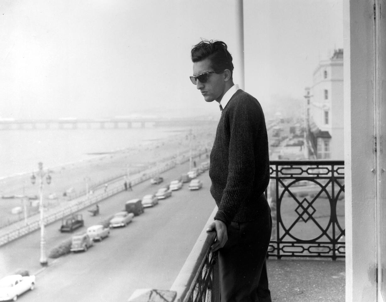 1961:  Indian cricketer and captain Mansur Ali, Nawab of Pataudi, on a balcony overlooking an esplanade and beach.  (Photo by Express/Express/Getty Images)