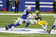 Green Bay Packers' Marquez Valdes-Scantling (83) makes a catch against Indianapolis Colts' Julian Blackmon (32) during the second half of an NFL football game, Sunday, Nov. 22, 2020, in Indianapolis. (AP Photo/Michael Conroy)
