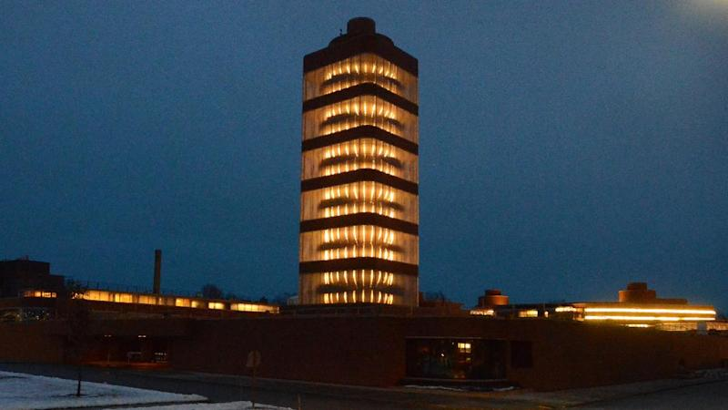 This Dec. 21, 2013 photo provided by SC Johnson shows the SC Johnson Research Tower designed by Frank Lloyd Wright lit up at night in Racine, Wis. Home products giant SC Johnson is opening the building for public tours for the first time starting May 2. (AP Photo/SC Johnson, Mark Hertzberg)