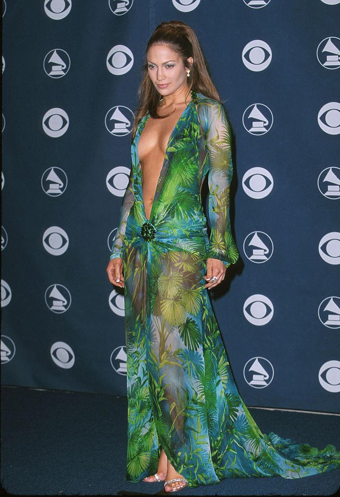 <p>Jennifer Lopez's green Versace look at the 2000 Grammy Awards is arguably one of the best red carpet looks of all time. Fun fact: J. Lo reprised this very look in 2020, and it was just as magical. (Image via Getty Images)</p>